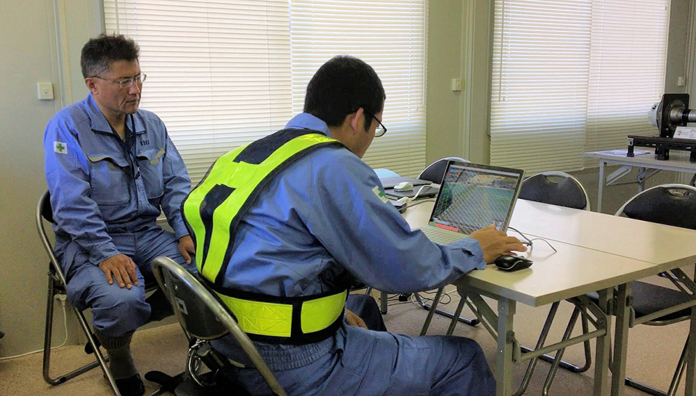 Quality assurance personnel viewing images relayed via the Internet